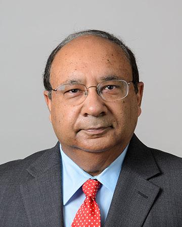 Headshot of a South Asian man
